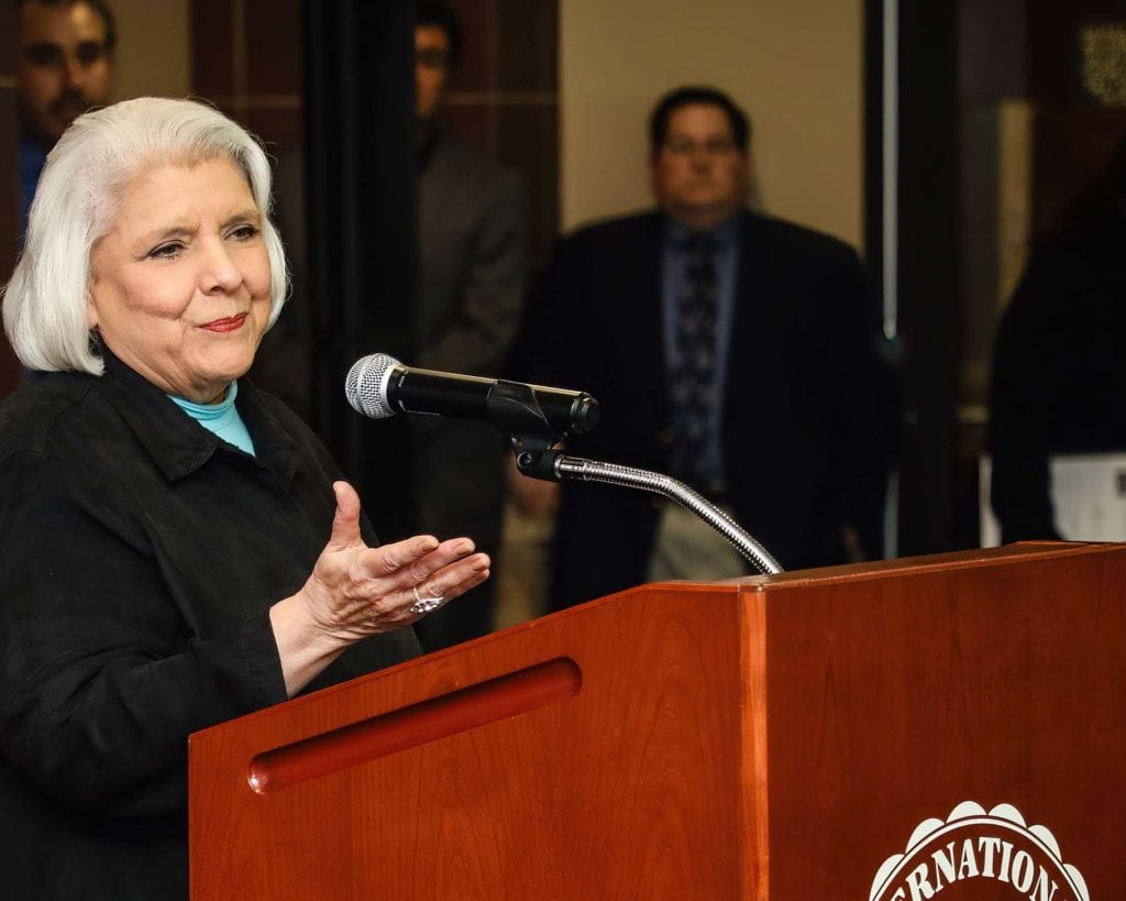 FEATURED: Sen. Judith Zaffirini, D-Laredo/Starr County, addresses students, staff and facility at Texas A&M International University–Laredo on Friday, December 7, 2018. For her work on transparency in government during the 87th Texas Legislature in 2021, Zaffirini on Tuesday, October 5, 2021, was honored at her Capitol office as a Champion of Transparency by the Texas Press Association.  Photograph Courtesy TEXAS A&M INTERNATIONAL UNIVERSITY–LAREDO